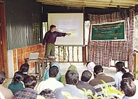 Image of Kyes teaching in a foreign country