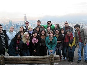 Photo: Students and Jaime Olavarria check out some of the beautiful vistas from a viewpoint about Santiago, Chile.